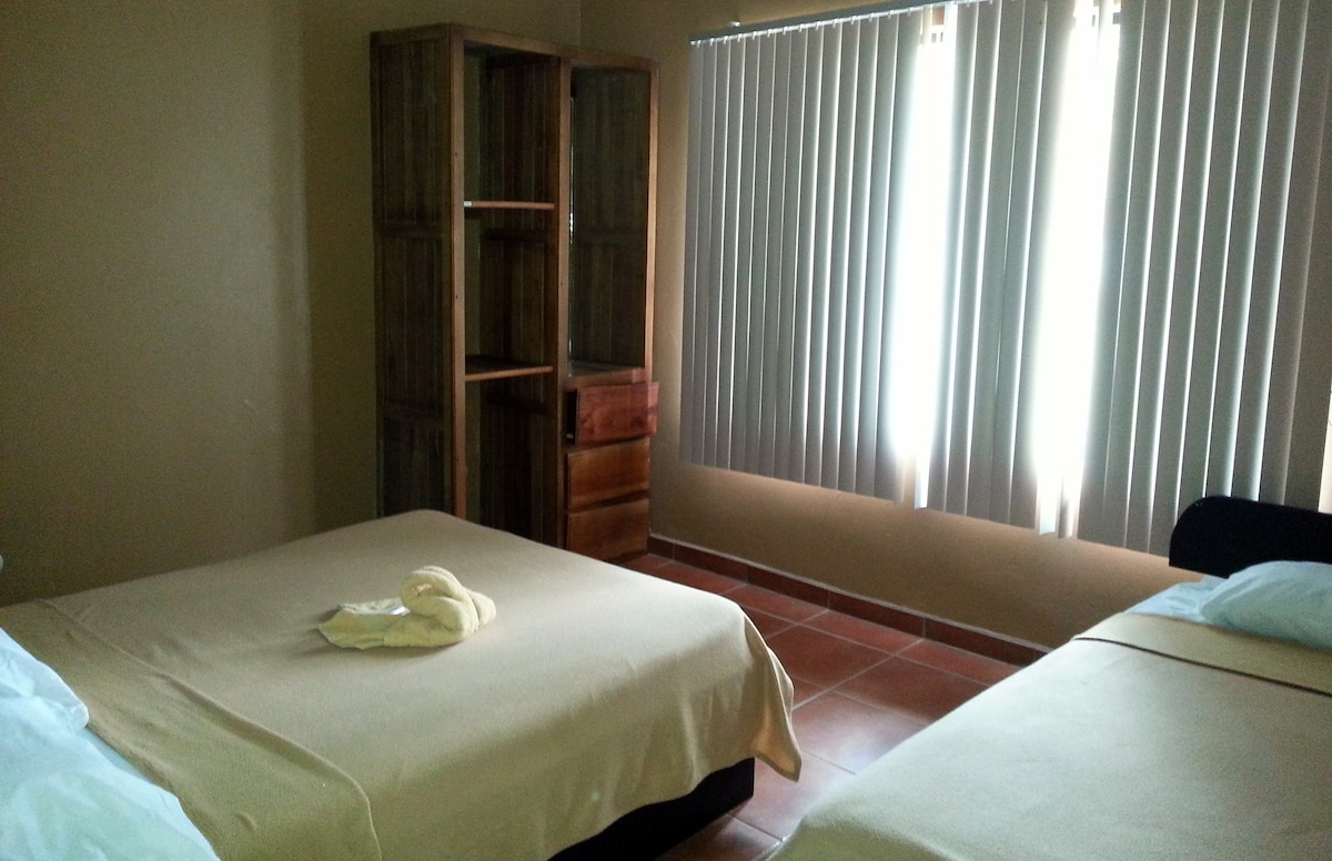 Bright spacious rooms with queen and single bed in each
