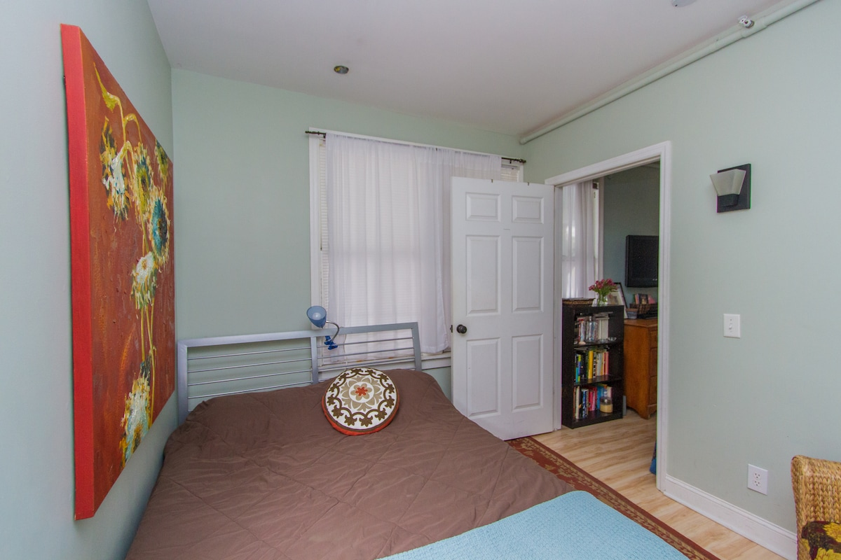 The Monet Room is located downstairs with a queen sized bed. The bathrooms are located upstairs.