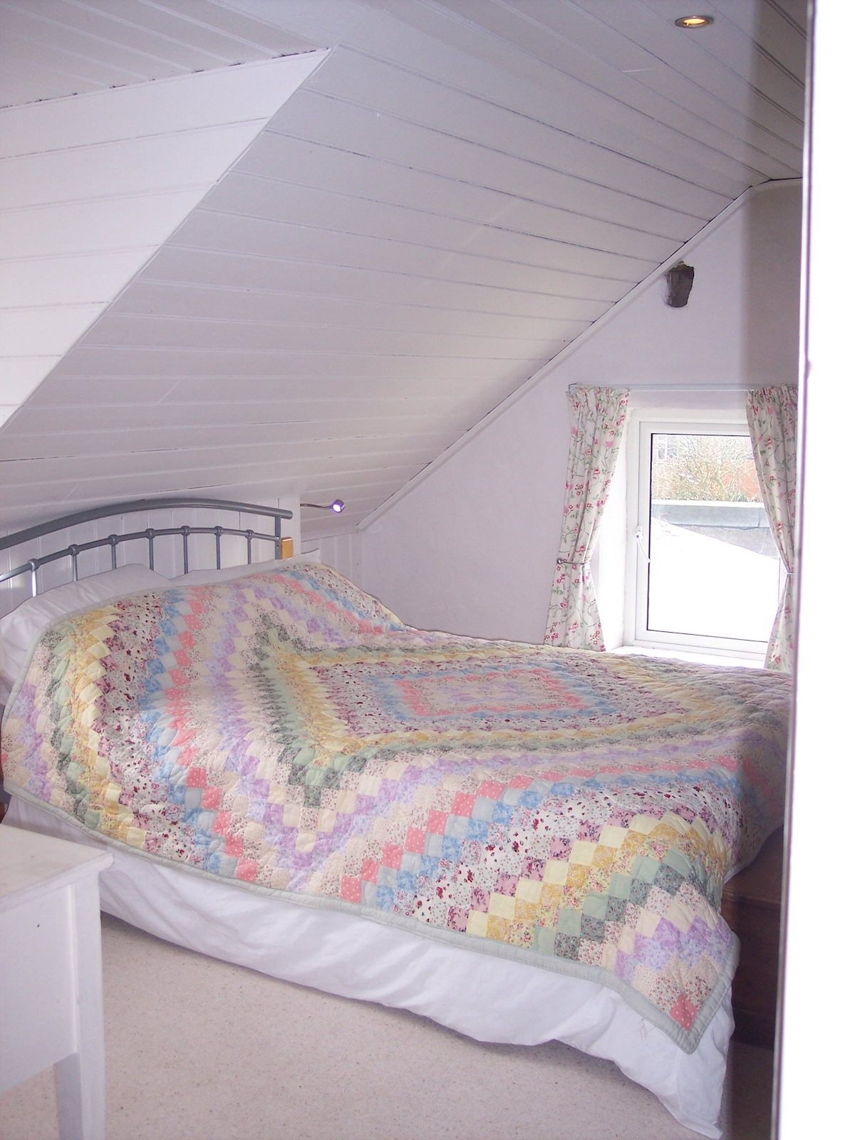 Comfy bed and a glimpse of the sea.