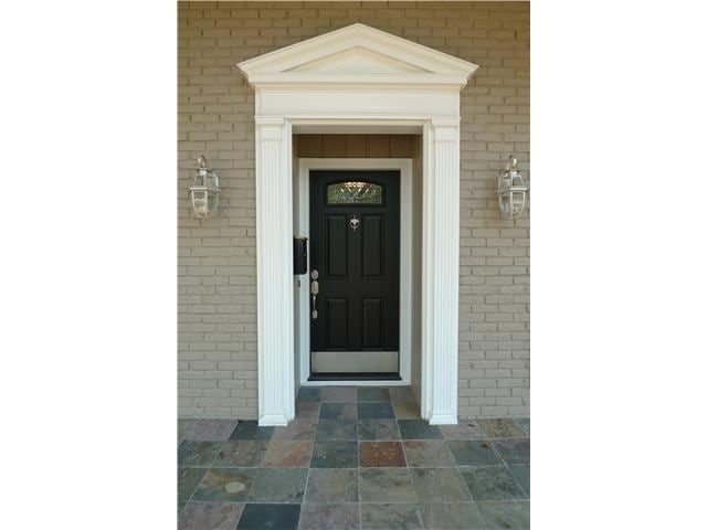A comfy place to call home, brand new everything including hand placed slate for the walkway.