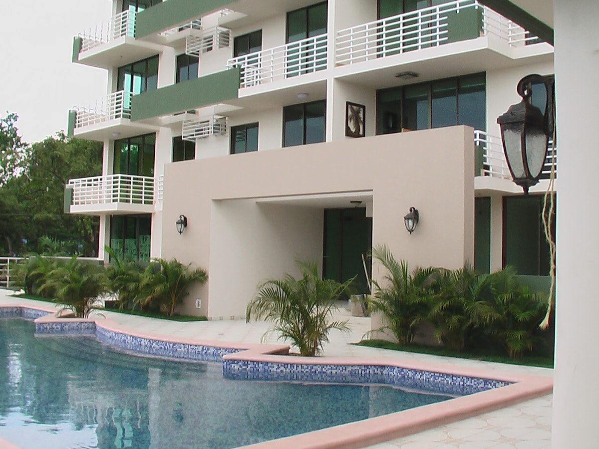 Rear of condo complex and pool