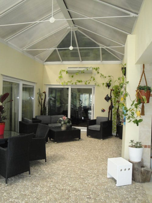 The Conservatory leading onto the Swimming pool.  The main bedrooms lead out onto this area.