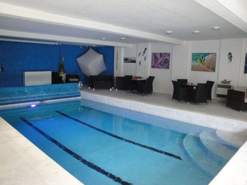 Indoor heated Swimming Pool - This room also has a theatre system with surround sound