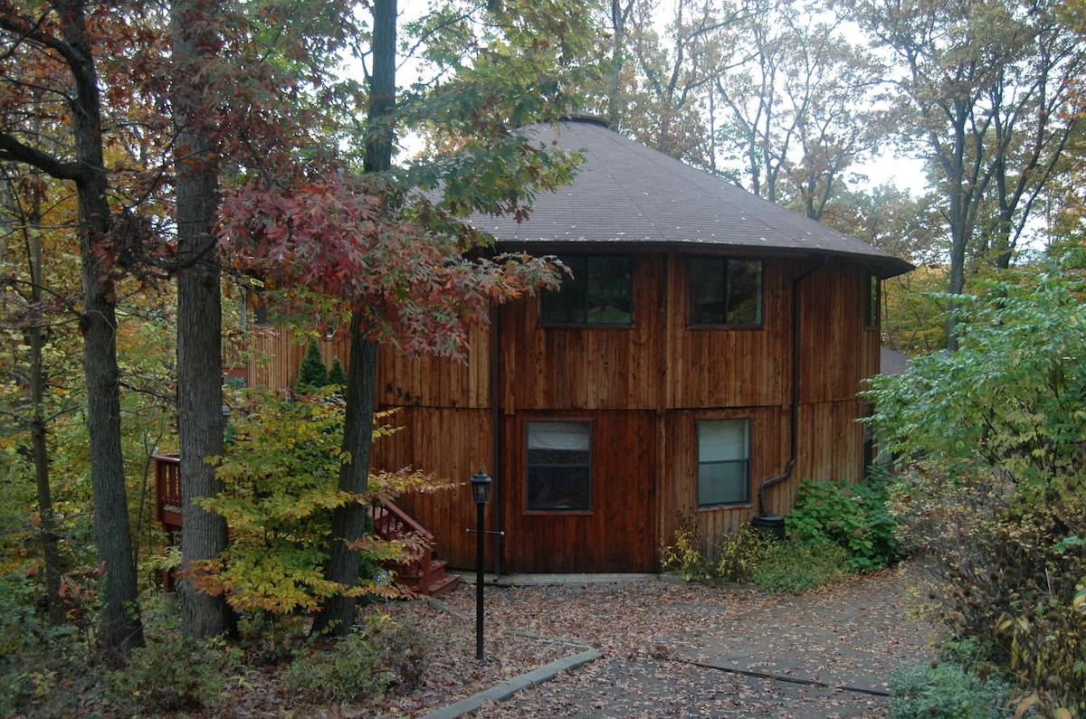 Our round house nestled in the trees