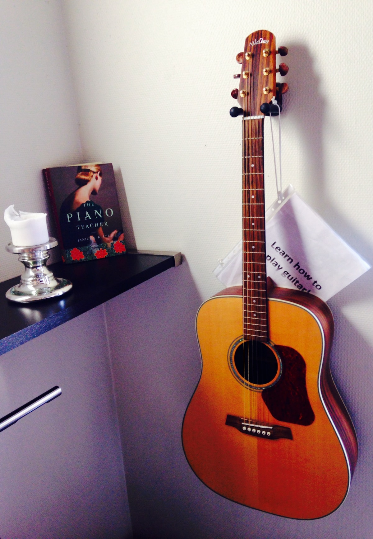 Use the guitar. Learn how to play with my booklet