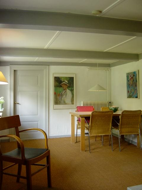 Eating area with door to children's bedroom and access to private garden. Highchair available for small children.
