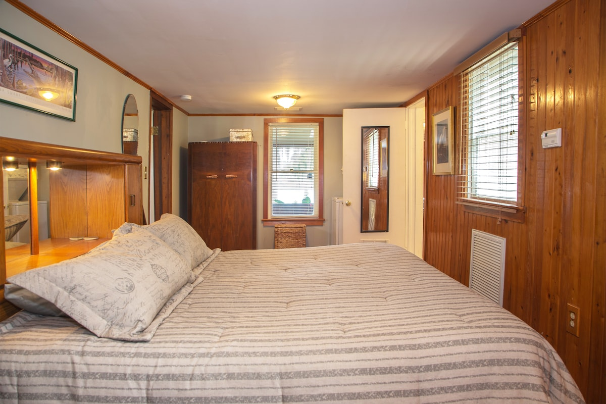 This is the Master Bedroom with King Bed, Scottish Armoire and new Flat Screen TV w cable. The Central AC/Heat thermostat is on the wall in this room