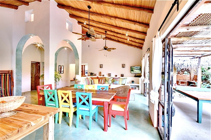 Dining & Living areas, with open air access to covered patio.