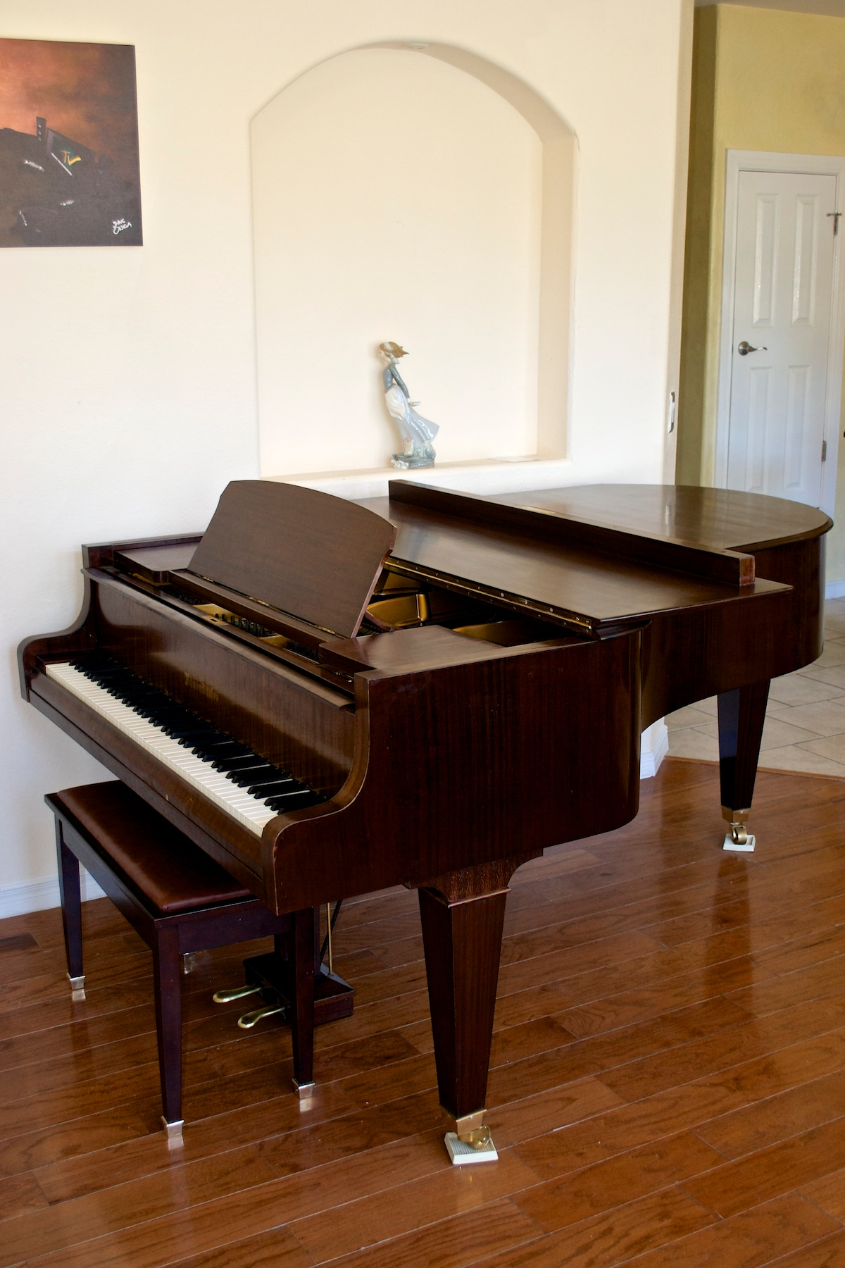 A Bosendorfer 7 foot grand piano graces the living room.  This is one of the finest piano makers in history, most say to rival Steinway.