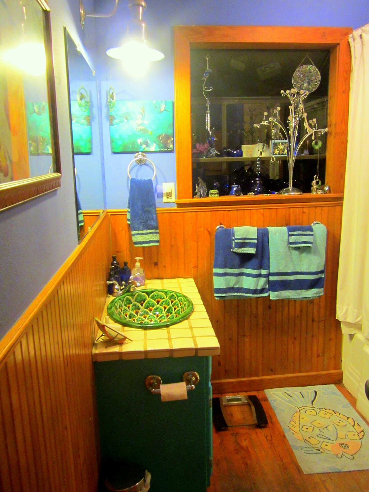 This is another view of your private bath, very colorful, with both shower and tub across from your downstairs bedroom.