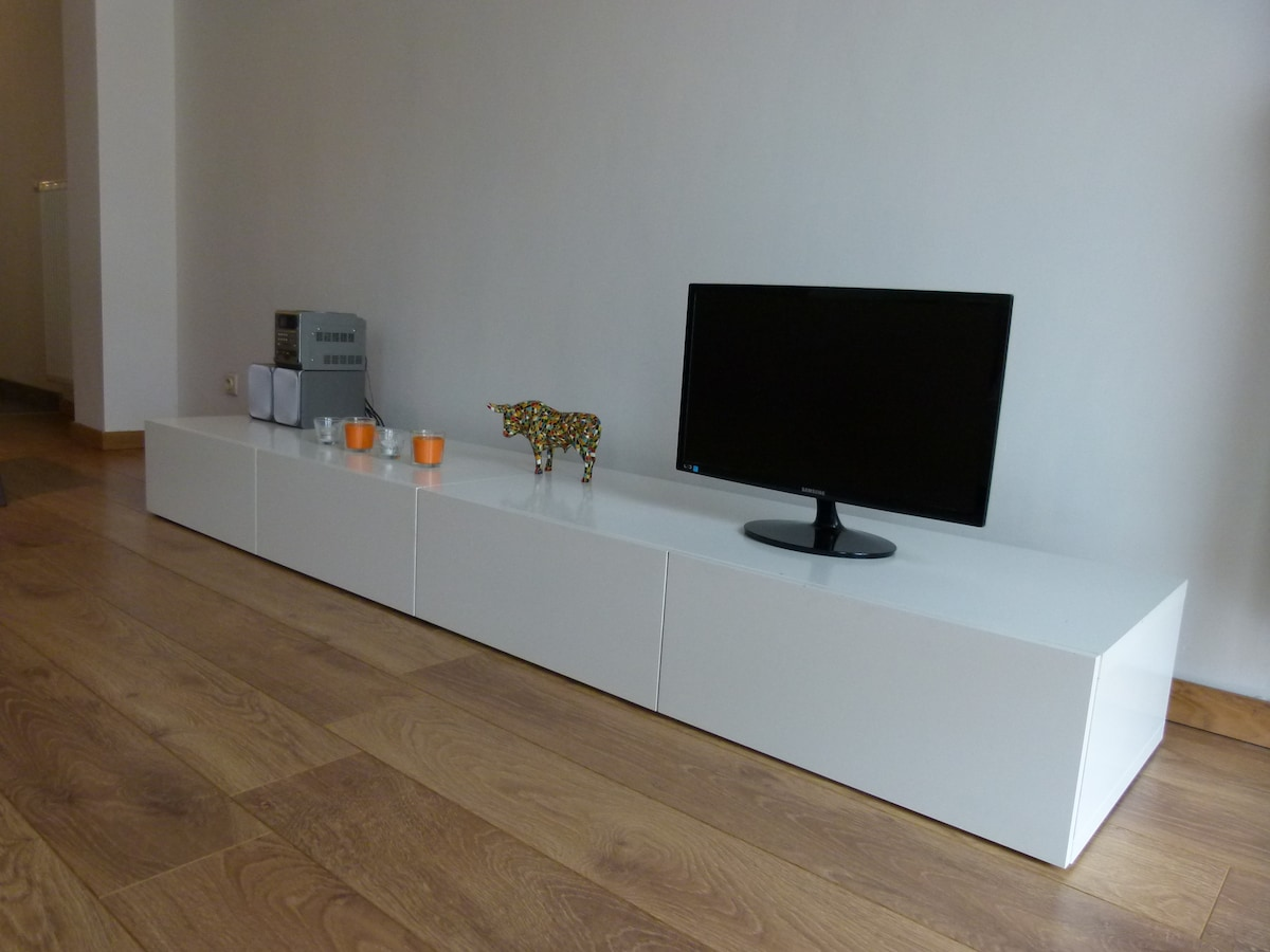 Low cupboard with stereo and tv set