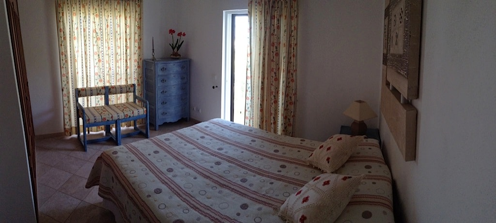 Spacious bedroom with a queen size bed, large closet and sliding doors to balcony...