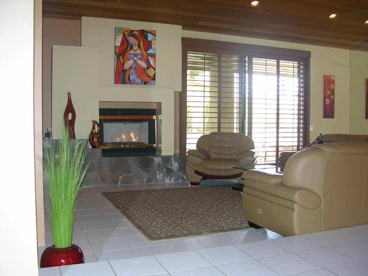 Living Room with Fireglass Fire Place