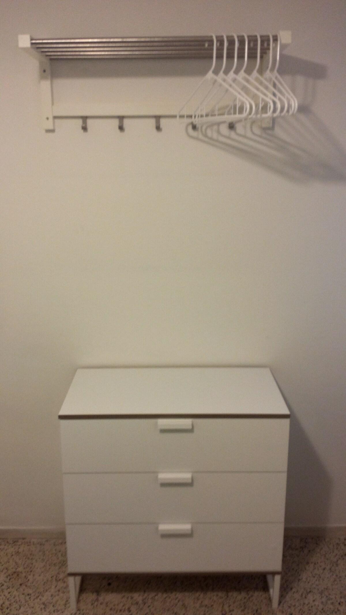 Bedroom's dresser drawer and hangers