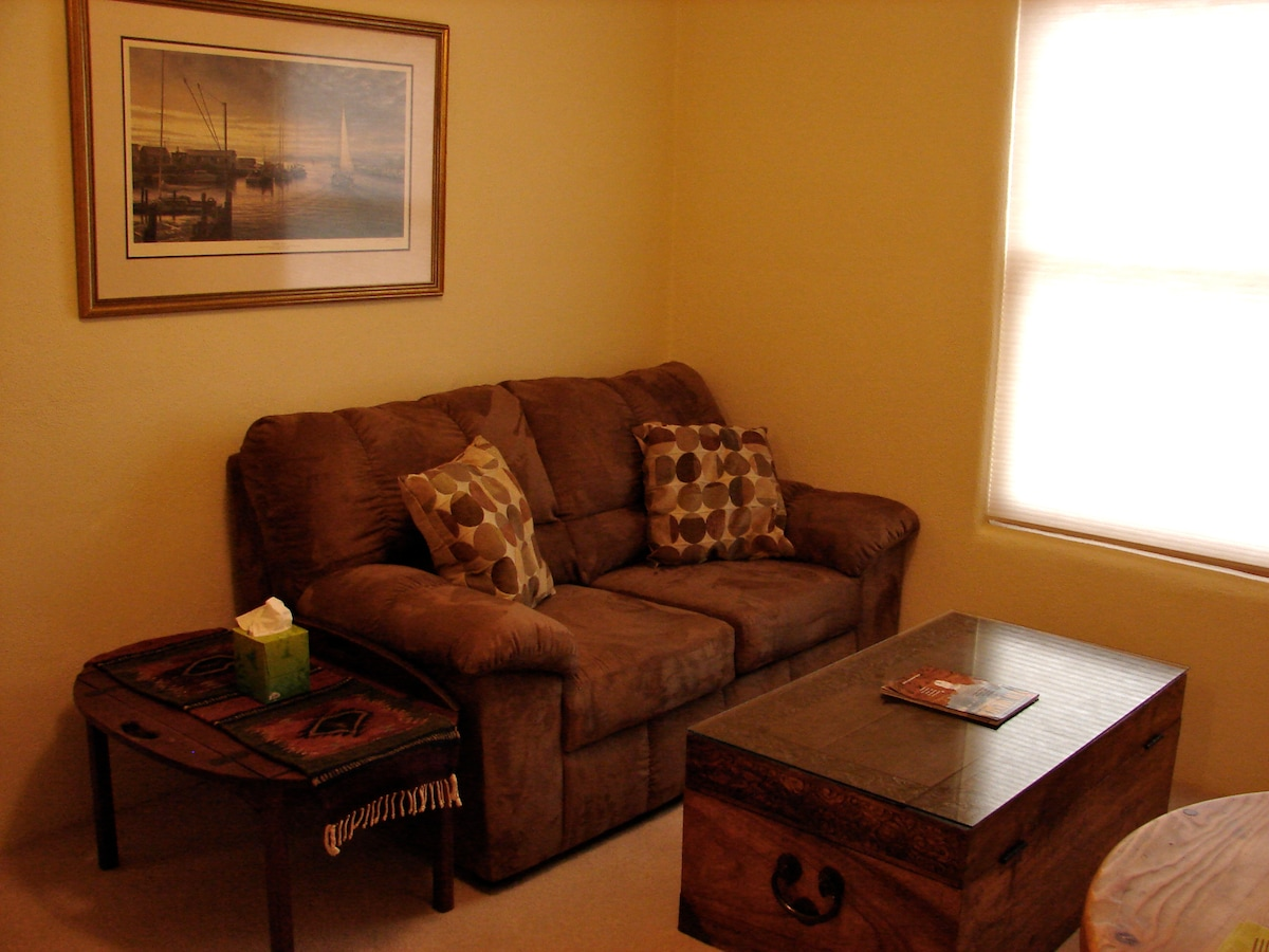 This sofa has been replaced with a fold out double futon for extra bodies. We'll change the photo soon!