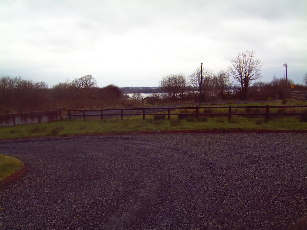 Plenty of private parking available .  Overlooking a large fishing lough.