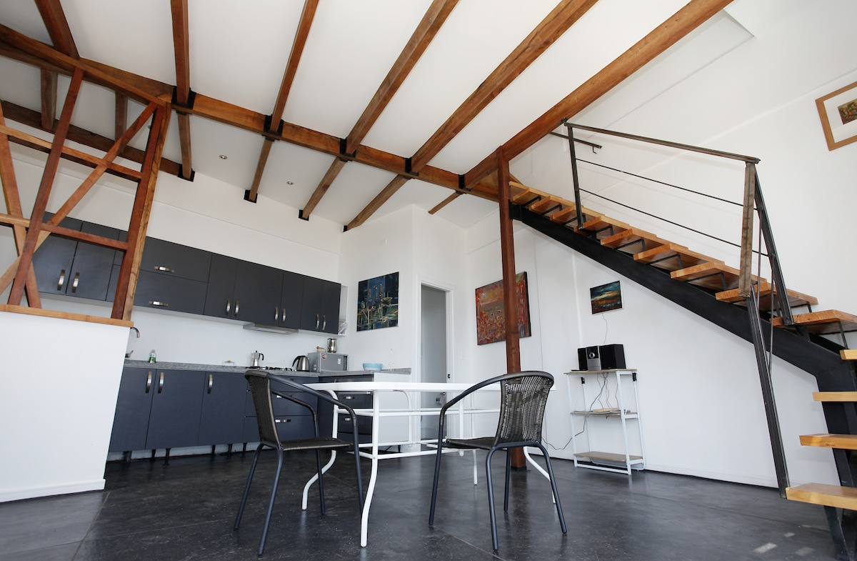 Modern clean and spacious design, high ceilings with beautiful oak beams