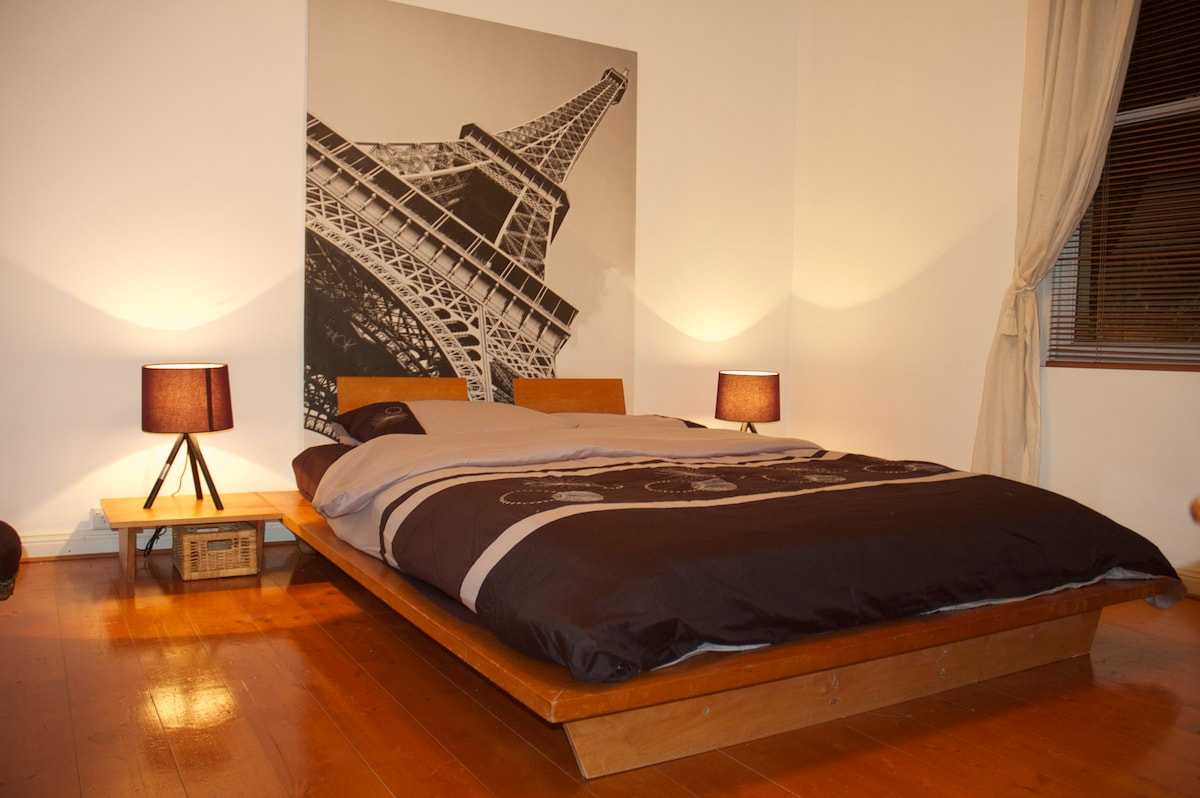 Bedroom 2 is furnished in an interesting French-Japanese fusion.  Centrepoint tower views from the window and Eiffel tower views from your pillow.