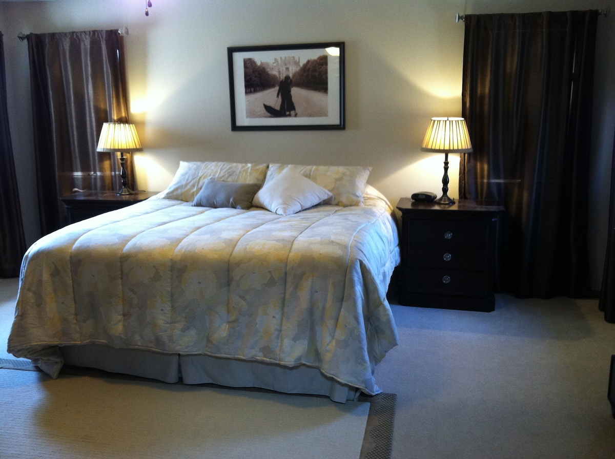 Master bedroom upstairs with king bed.