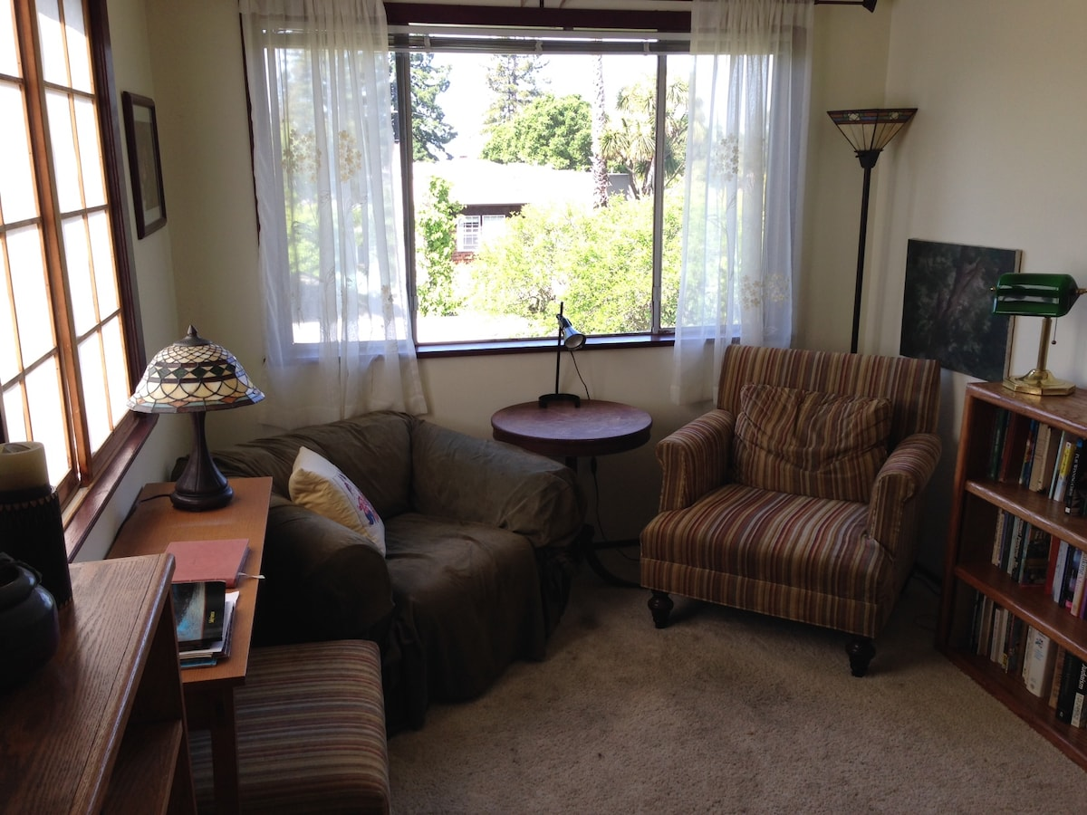 Cozy sitting room and library - you can see the SF bay from the stripy chair.  Also overlooks our sweet backyard.