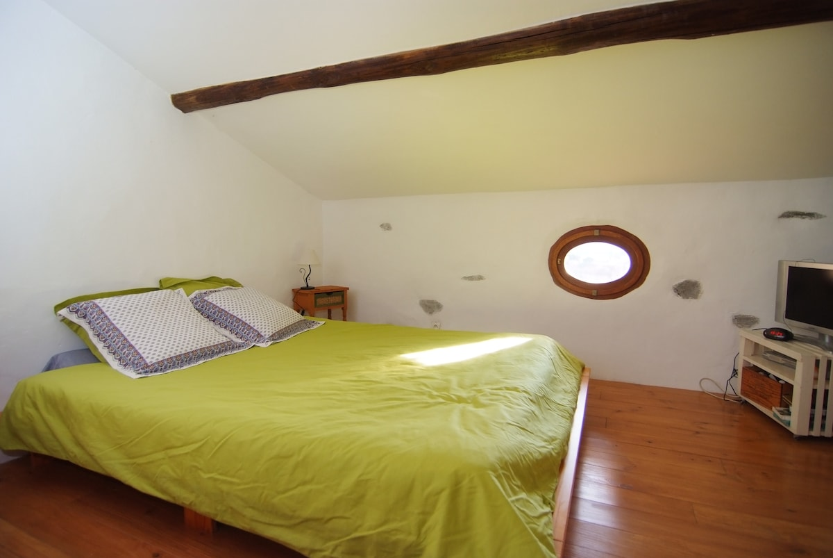 Double bedroom with ensuite shower room with view over the river.
