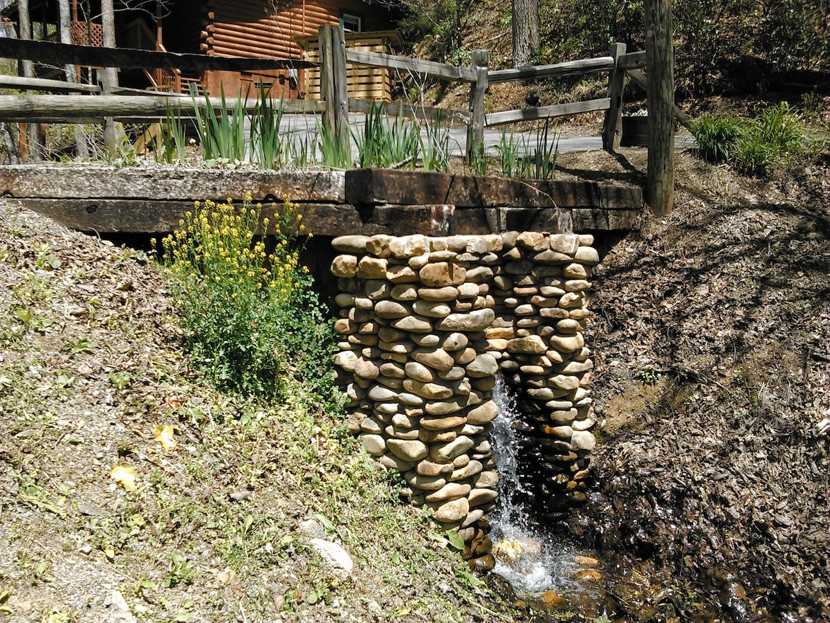 Waterfall flows into a creek that is also on this nice property!