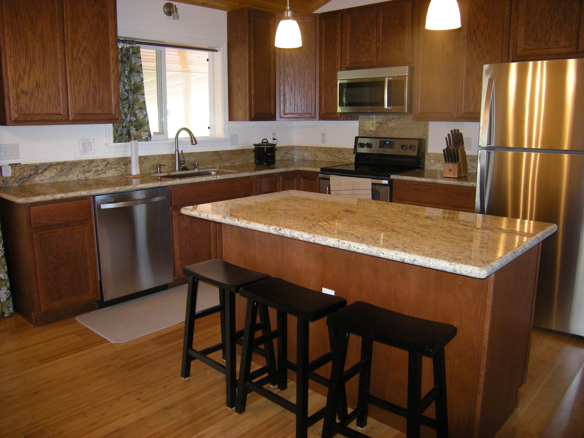 Spacious Kitchen with granite countertops and stainless steel appliances