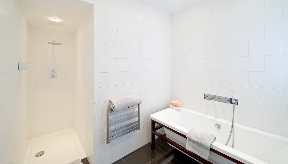 The en suite with walk in shower & separate bath