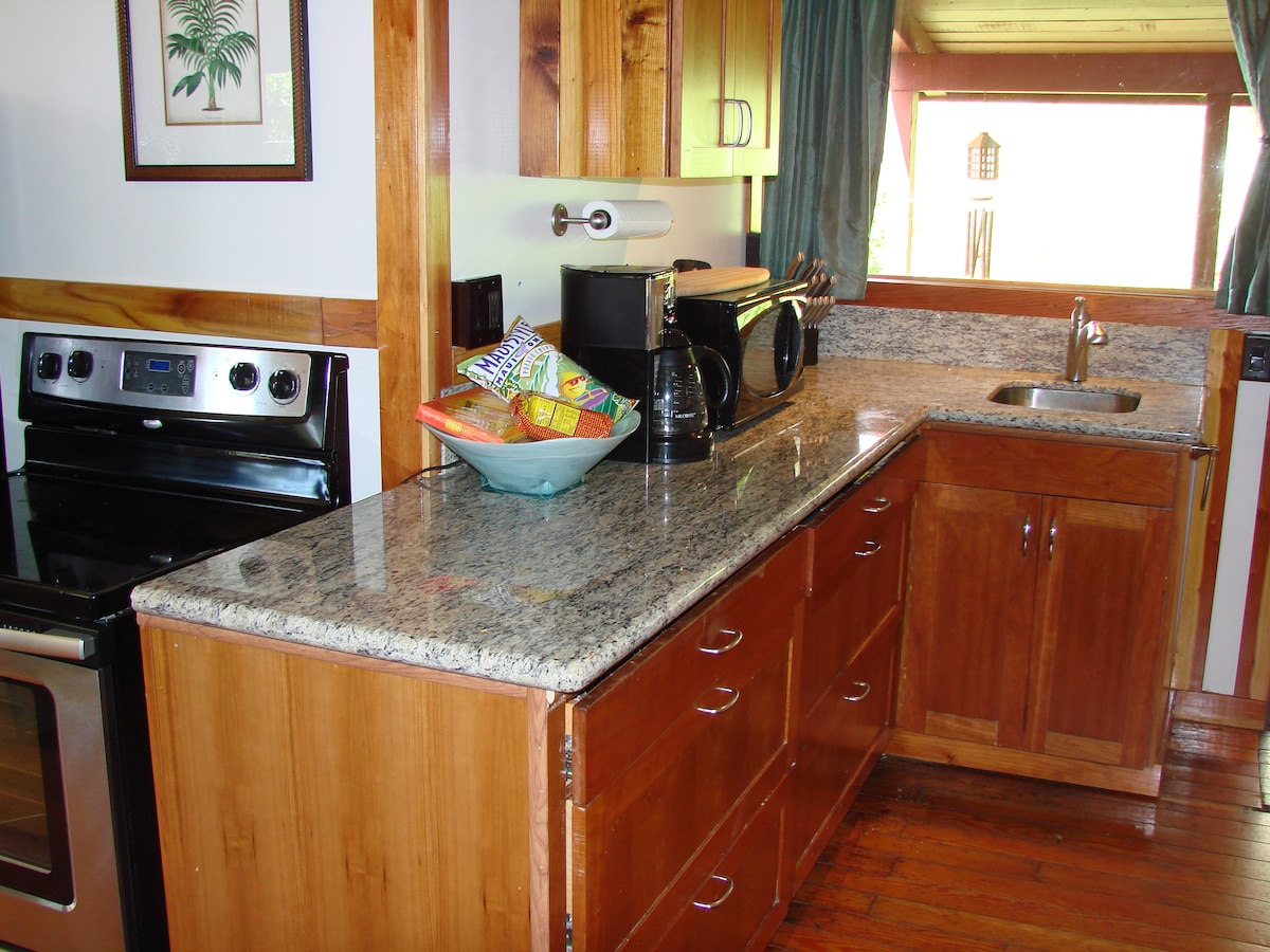 Brand new granite countertops and cherry wood cabinets with a welcome gift basket containing Maui goodies...