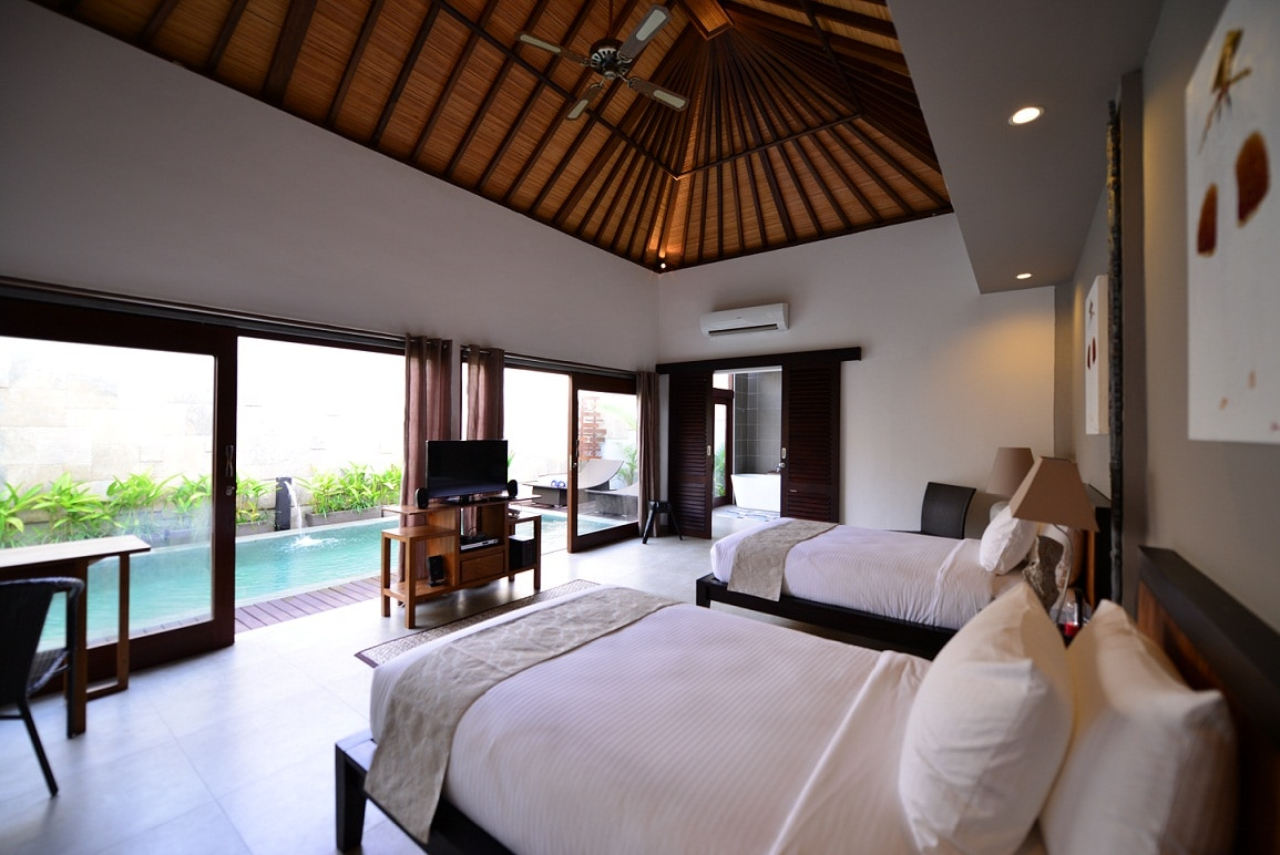 Each villa's bedroom overlooks the pool