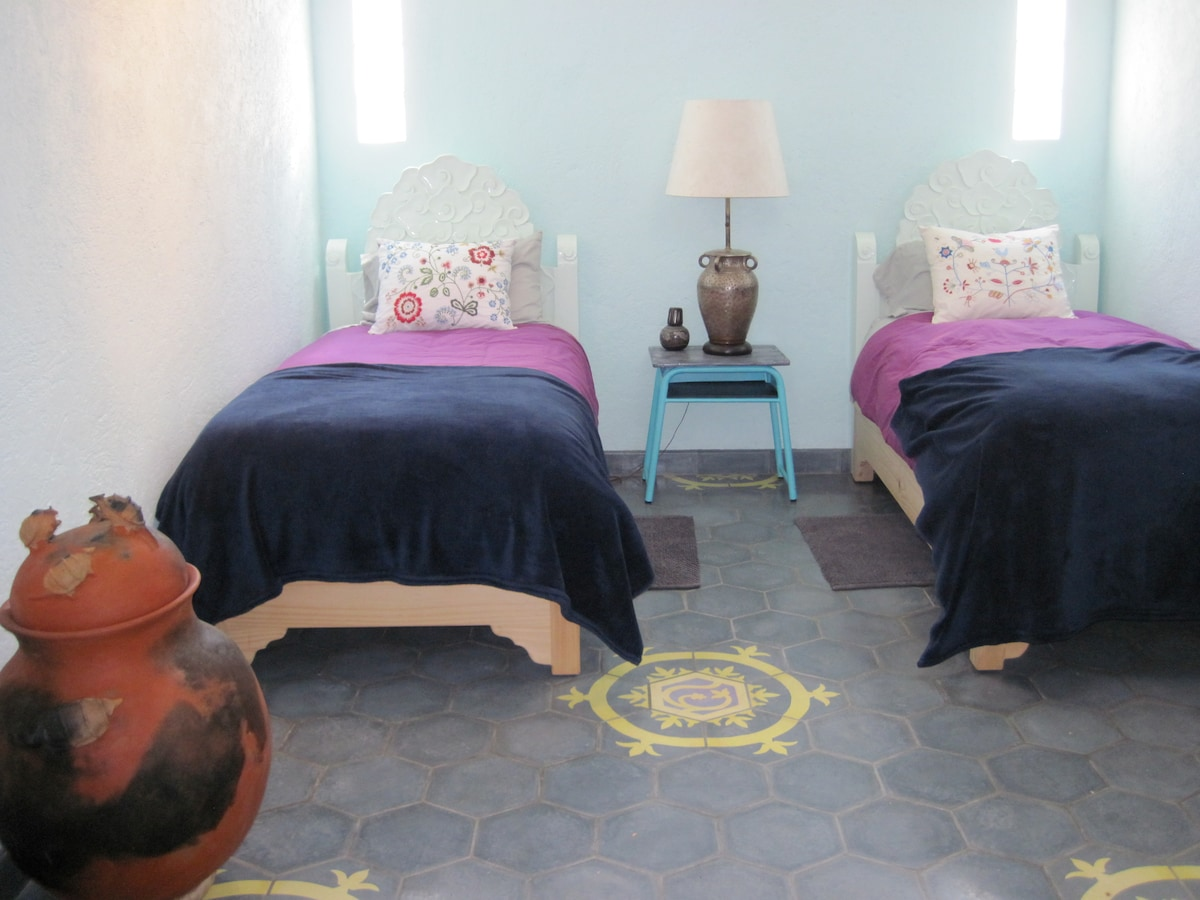 CLOUD NINE located on the 2nd floor of the Golden Bee: Has 2 Twin beds and bathroom.