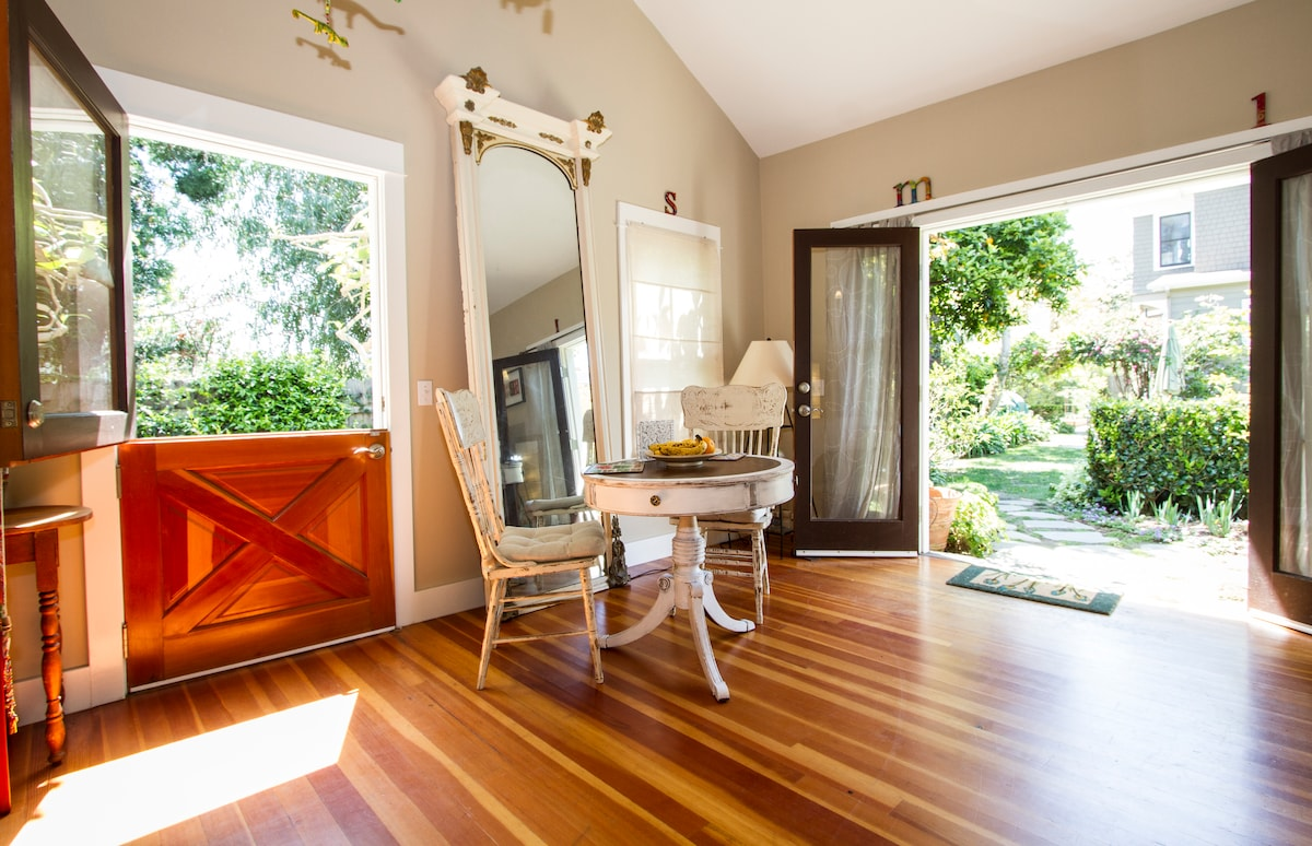 Eating nook floats between the wooden french doors and Double Dutch door that open to the serene gardens.