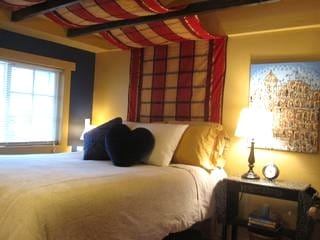 The comfy, cozy, and romantic bedroom in the Hideaway, a Wrightwood cabin rental 5 miles to Mt. High.