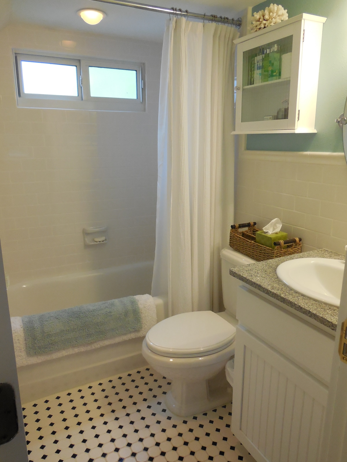 The first floor bathroom with tub / shower combination.