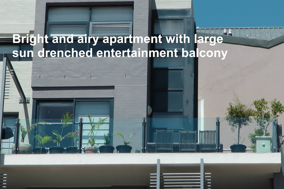 This apartment is bright and cheerful  with its huge balcony and neighbours on one side only.
