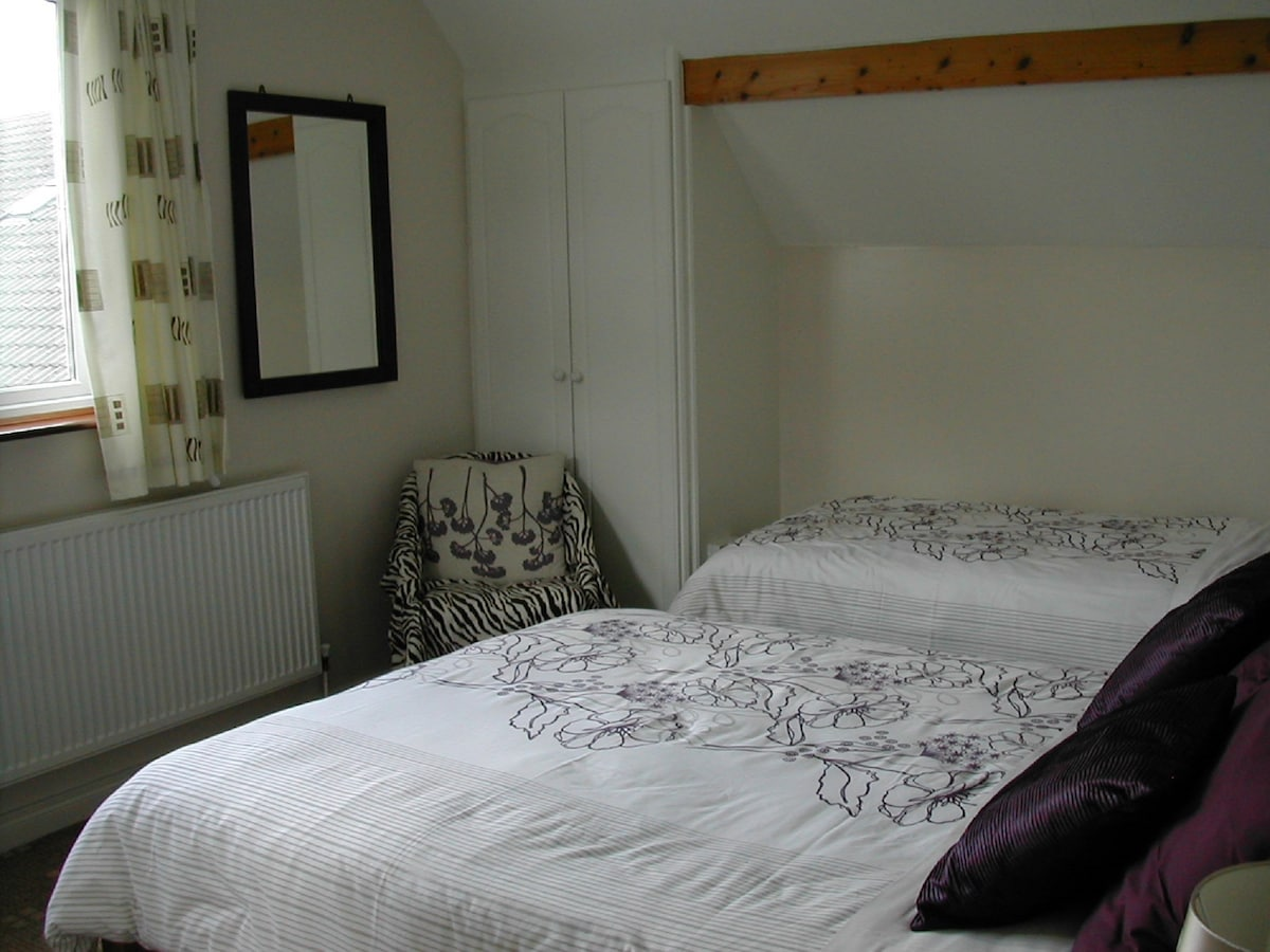 Our triple en-suite bedroom facing west. A lovely bright room