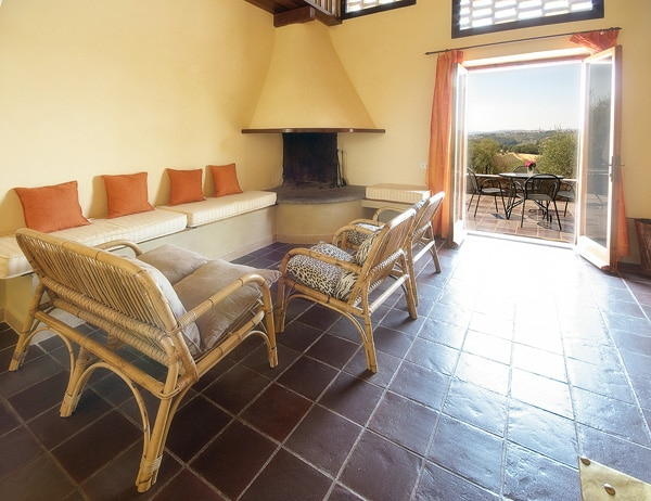 Guest lounge overlooking the private terrace, private pool and breathtaking sunsets over Siena