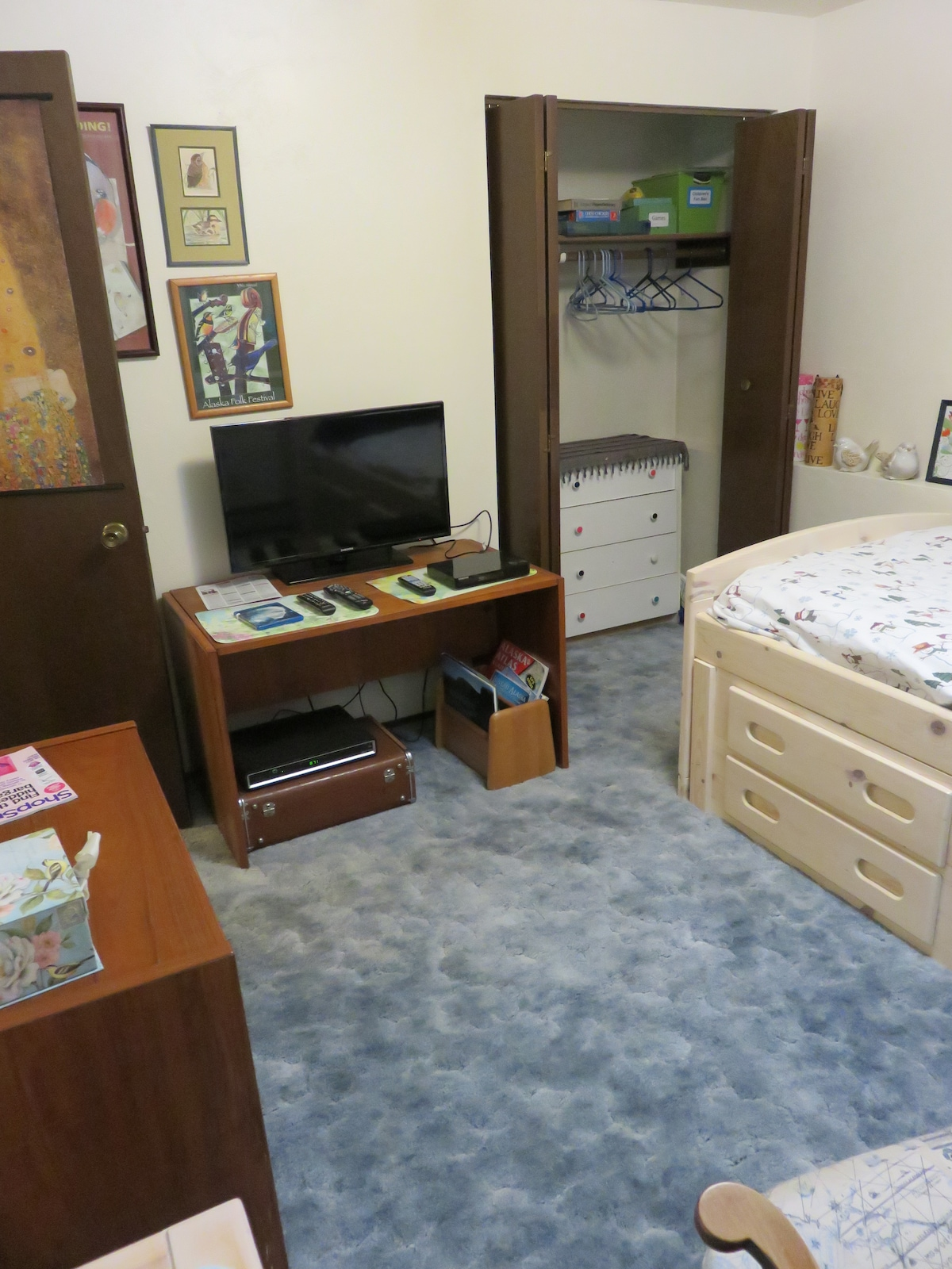 TV with Cable and music channels. Twin bed with drawers.
