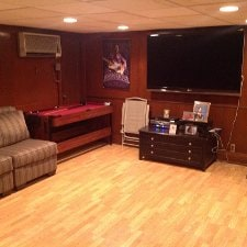 This is a large theatre room with a 64' TV. Pool table and schuffle board. This has two beds with a private bath room.