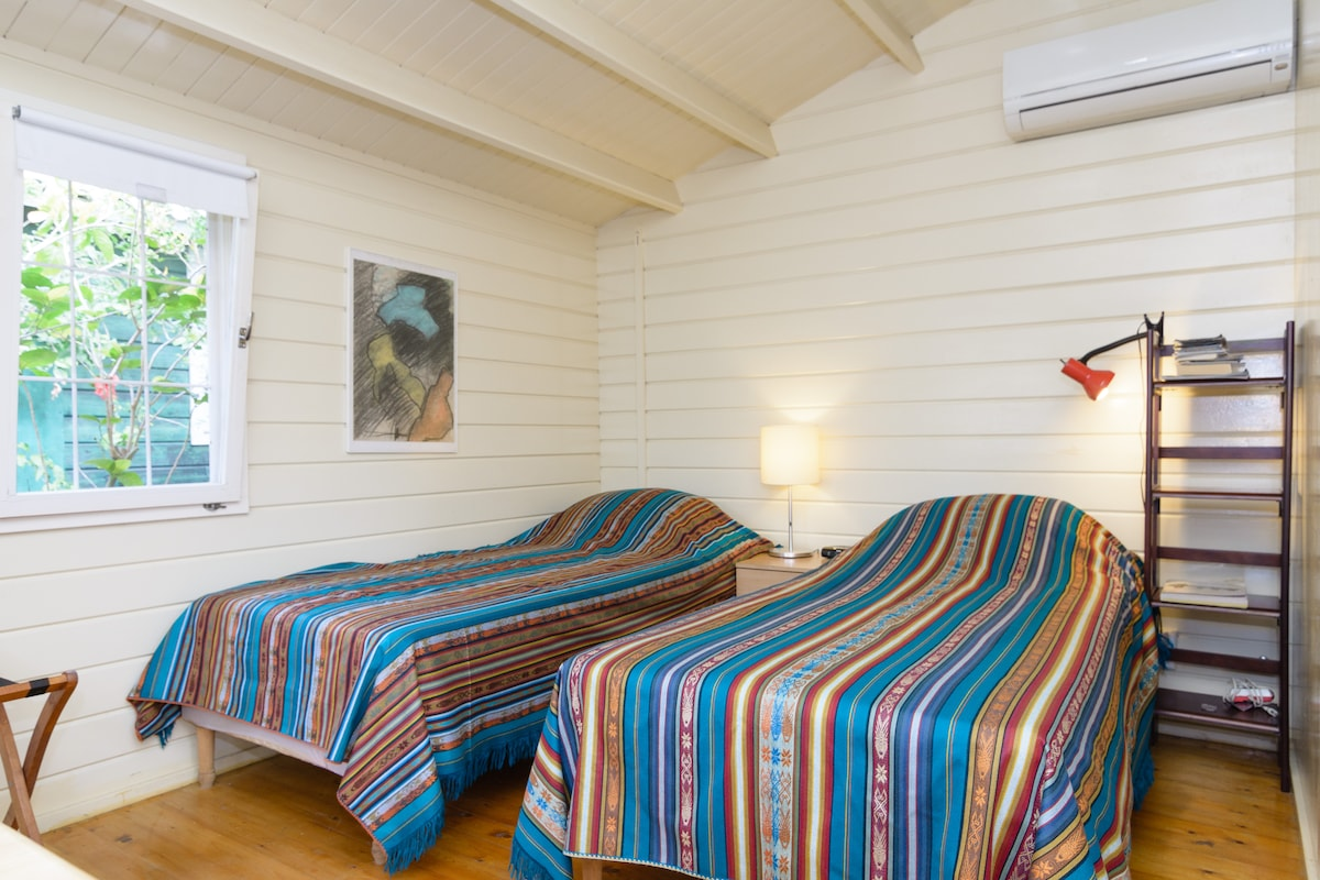 Two single beds and air conditioning