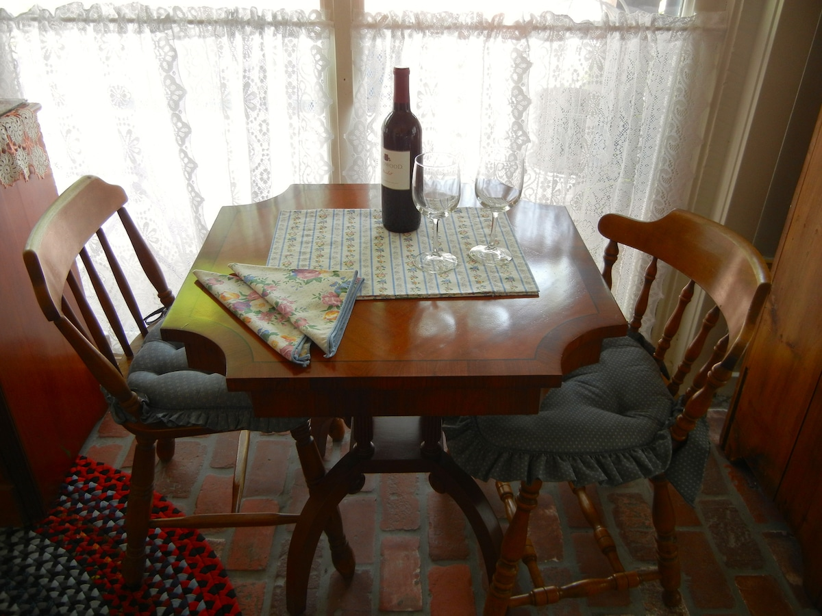 Antique table for two with complimentary bottle of wine.