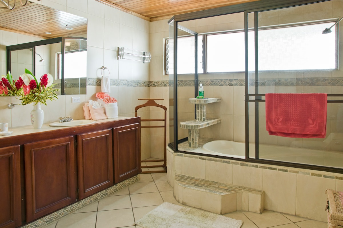 Extra large bathroom with bathtub, His & Hers sink and extra large mirror over a 6-foot vanity