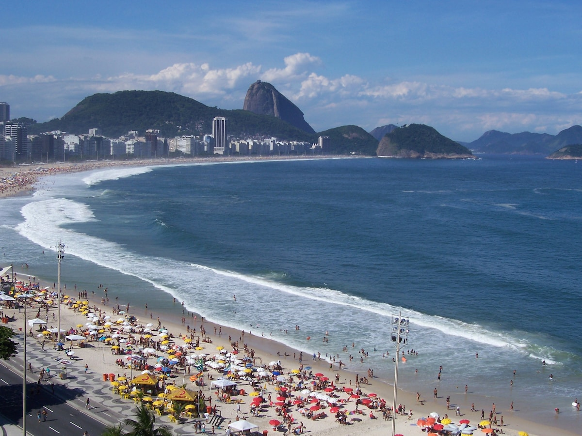 This is another typical view from our apartment window of Copacabana Bay and SugarLoaf.  You can hear the ocean waves, and feel the breezes all day, and all night long! (Photo by Marty & Anthony)