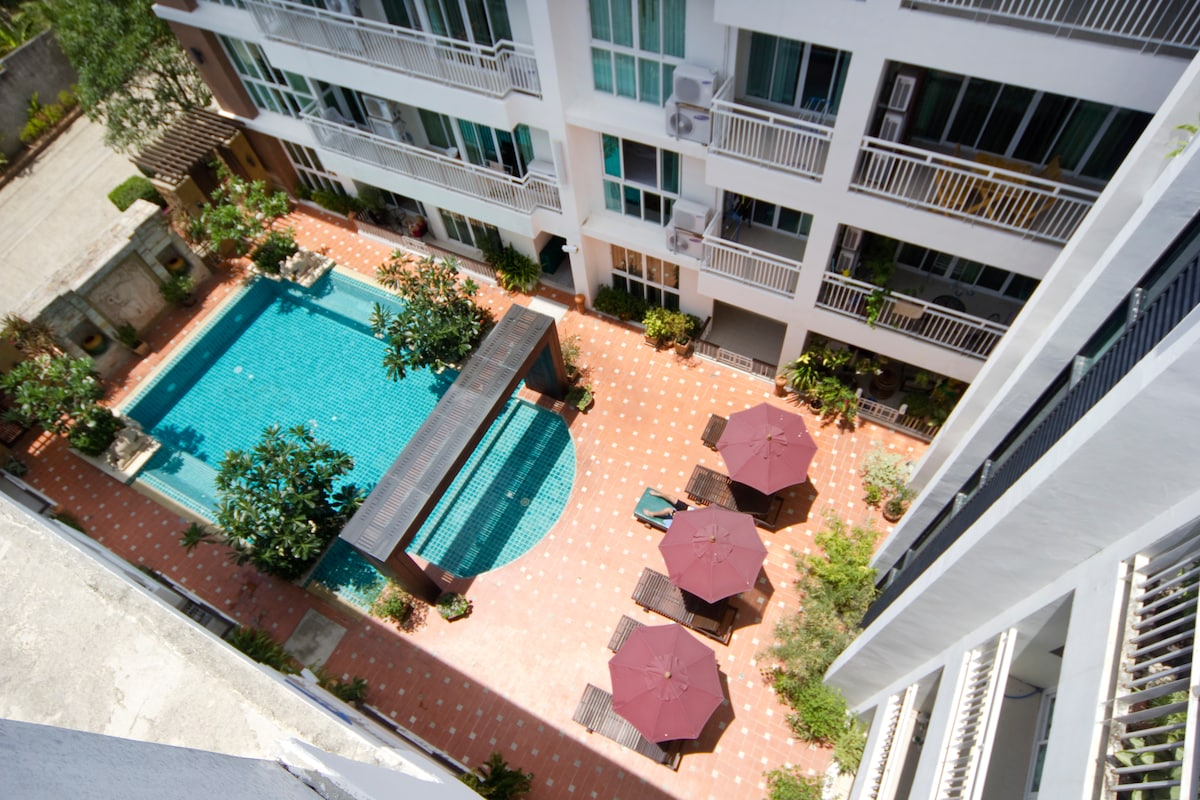 View of the pool and sundeck from rooftop