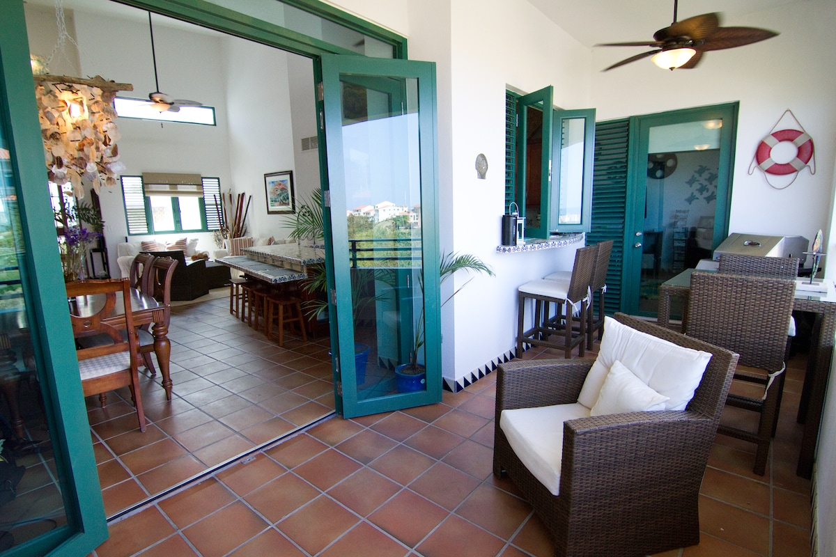 Villa opens up to the balcony, great for entertainment and maximizing the tropical breezes!