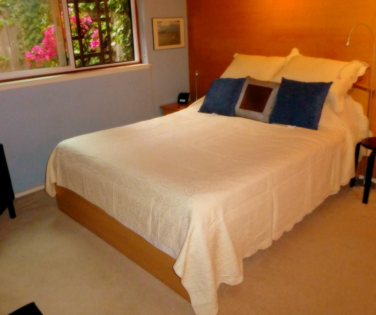 """Queen size bed in bedroom.  Bed has 9"""" Tempurpedic memory-foam mattress."""