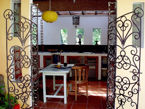 """THE KITCHEN:  WELL EQUIPPED, SHARED WITH THE LADY WRITER WHO LIVES HERE.  """"MAYA"""" HAS BEEN RENOVATED BY HER WITH A TEAM OF LOCAL WORKERS - RECLAIMED WROUGHT IRON GATES - CAMPHER WOOD CABINETS."""