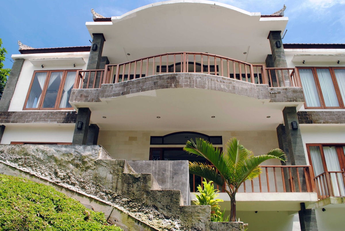 Looking up to the main entrance to the villa with the second and third floor balcony areas