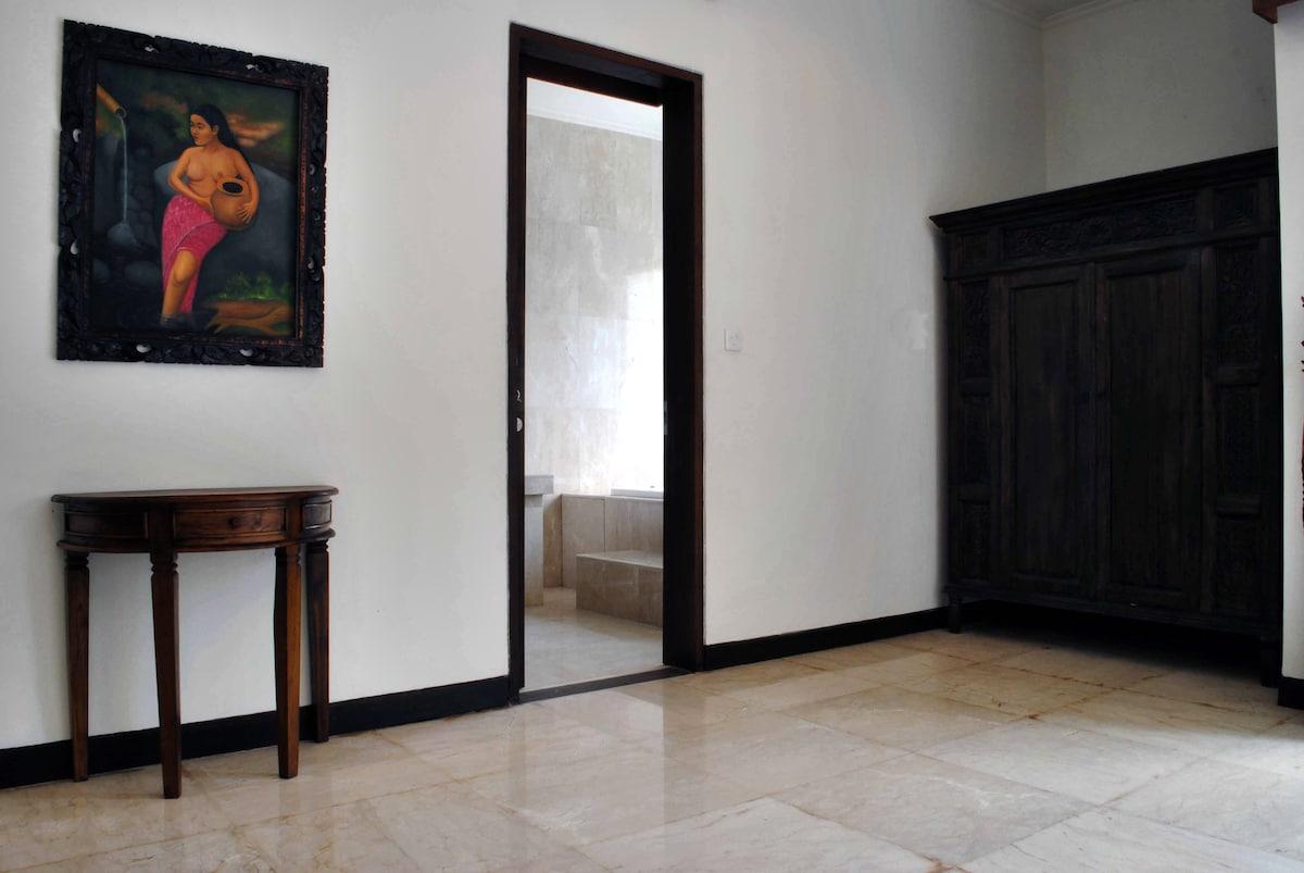 The adjacent master bathroom