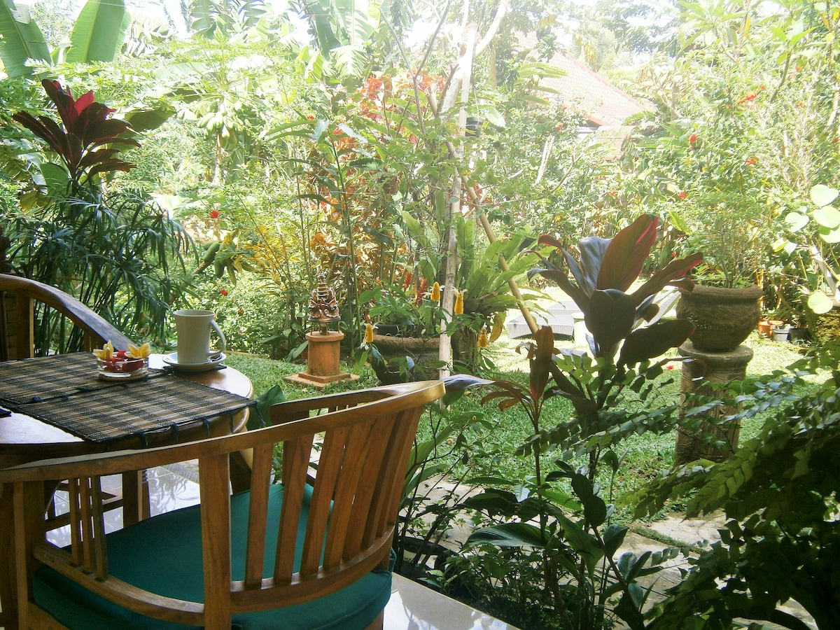 Your balcony overlooks the tropical garden with birds and butterflies